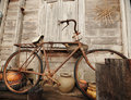 Old Bicycle and old wood house Stock Photography