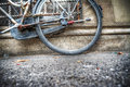 Old bicycle rear wheel agsinst a rustic wall Royalty Free Stock Photo