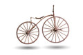 Old bicycle with wooden wheels isolated with clipping path Royalty Free Stock Photo