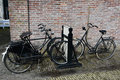 Old bicycles dutch pariked in a bicycle rack Stock Image