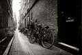 Old bicycles parked on a narrow street in Amsterdam Royalty Free Stock Photo