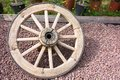 Old big wooden wheel for the cart one with spokes ancient closeup and a blank space Royalty Free Stock Images