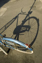 Old bike with its shadow Royalty Free Stock Images