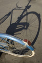 Old bike with its shadow Stock Photography