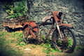 Old bike leaning on the street of a village in spain behind is an carriage and photo has vignetted background Royalty Free Stock Photography