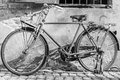 Old bike in old wall background. Royalty Free Stock Photo