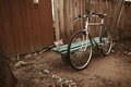 Old bike on the street vintage photo Royalty Free Stock Photos