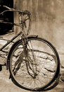 Old bike by wall Stock Images