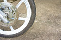 Old black magnesium alloy wheel of motorcycle and disc brake on the left Royalty Free Stock Photos