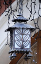 Old black metal wall streetlight antique victorian outdoor lamp Royalty Free Stock Photo