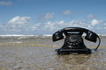 Old black retro phone beach Stock Photography