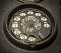 Old black telephone close up of a rotary dial Stock Image