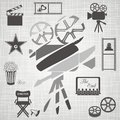 Old black and white movie camera with movie icons on retro background Stock Photos