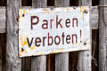 Old blank metal sign no parking in germany translation no parking Royalty Free Stock Photo