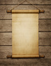 Old blank paper scroll grunge on the wooden wall with copy space Royalty Free Stock Photos