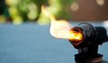 Old blowtorch with fire Stock Photography