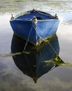 Old blue boat its reflexion Royalty Free Stock Photo