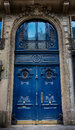 Old Blue carved ornate door in Paris, France. Royalty Free Stock Photo