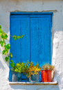 Old blue colored window from a greek house Royalty Free Stock Images