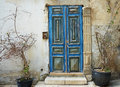 Old blue door against an old stone wall