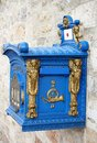Old blue german mailbox with gold details Royalty Free Stock Photo