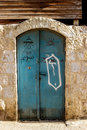 Old blue metal dirt door with keyhole and rusty metal lockas a beautiful vintage background Royalty Free Stock Photo