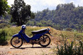 Old blue moped/motorbike in rural Bali Royalty Free Stock Photo