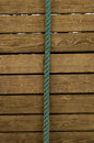 Old blue rope on wooden Royalty Free Stock Photo