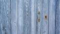 Old blue run down wooden door and lock closeup of vintage iron Stock Photos