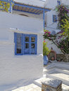 Old blue white house and picturesque alley greece Royalty Free Stock Images