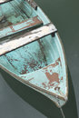 Old blue wooden boat on the lake. Royalty Free Stock Photo