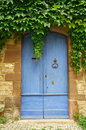 Old blue wooden door closed Stock Photography