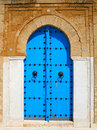 Old blue wooden door in tunisian arabic style Royalty Free Stock Photo