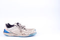 Old blue worn out futsal sports shoes on white background isolated Royalty Free Stock Photo