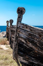 Old boat on the beach in sicily island Stock Photos