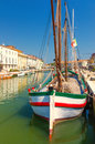 Old boat on the canal ancient rowboat in open air museum cesenatico italy Royalty Free Stock Photography
