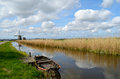 Old boat in a ditch in Holland Royalty Free Stock Image