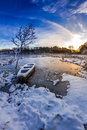 Old boat on the lake covered with snow in winter Royalty Free Stock Photos