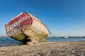 Old boat at low tide in france normandy shipwreck Stock Images