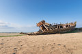Old boat at low tide in france normandy shipwreck Royalty Free Stock Photos