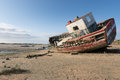 Old boat at low tide in france normandy shipwreck Royalty Free Stock Photo