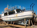 Old boat in repair yard under and renovation a agios nikolaos crete greece Stock Images