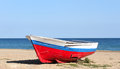 Old boat resting on the beach in badalona barcelona spain Royalty Free Stock Images