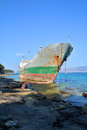Old boat stranded on the shore cargo rocks in croatia Stock Photography