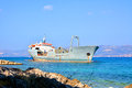 Old boat stranded on the shore cargo rocks in croatia Stock Images