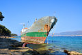Old boat stranded on the shore cargo rocks in croatia Stock Photo