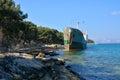 Old boat stranded on the shore cargo rocks in croatia Stock Image