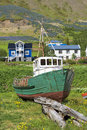 Iceland, old boat, wooden houses Royalty Free Stock Photo