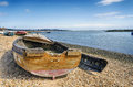 Old boat an wrecked wooden on the shore at poole in dorset Royalty Free Stock Image