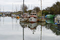 Old boats in a marina sailing and motor moored basin just off the river severn at lydney docks Royalty Free Stock Photography